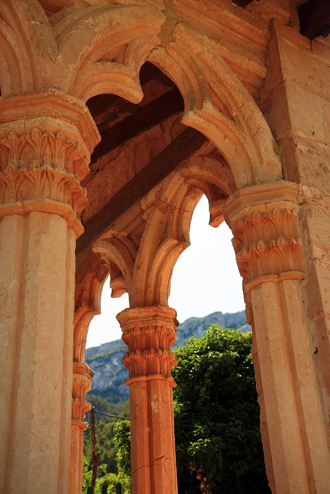 The rusty sandstone pillars of the Miramar Monastery easily make it one of the most beautiful houses and gardens in Majorca